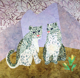 Raspberry Lane Crafts #5 Snow Leopards Quilt Block pattern is a picture of two snow leopards against a purple mountain range with yellow indian paint brush tundra.  Designed by Wendy Christine