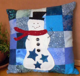 Star Snowman Pillow pattern photo features a white snowman, three blue stars, red scarf, black top hat, buttons sewn on a field of blue flannel squares.  Raspberry Lane Crafts. Buy Purchase for Sale.