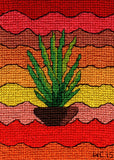 Yucca Pot cross stitch pattern is based on the art of wendy christine featuring a potted green yucca with wavy red, orange and yellow background.
