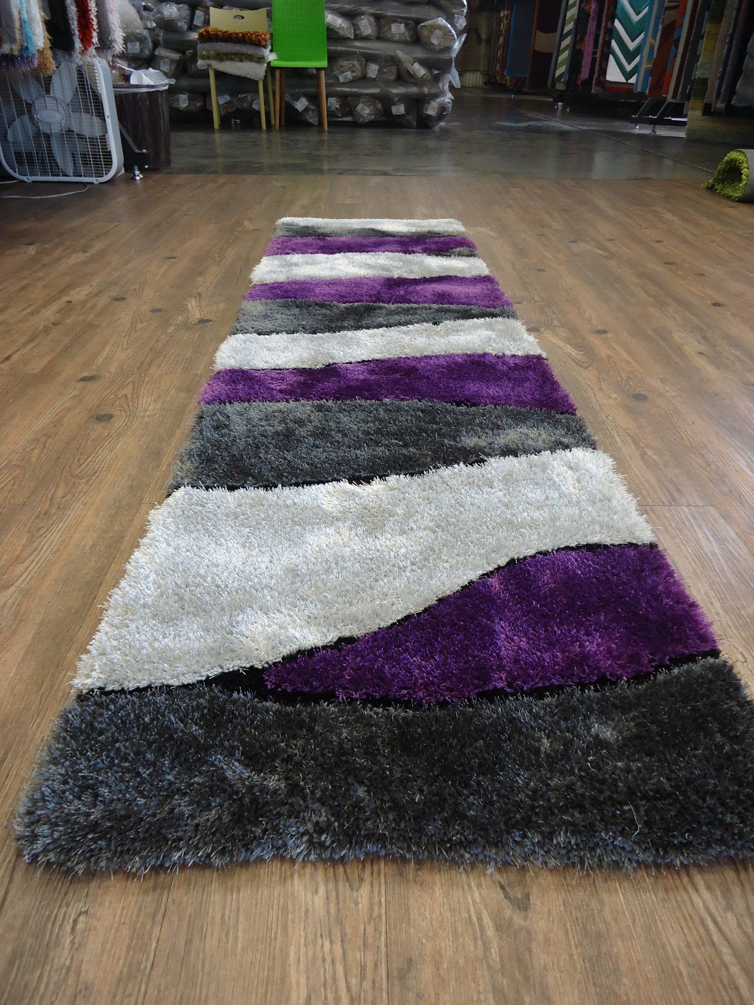 handmade vibrant gray with purple shag area rug with hand carved design area rug