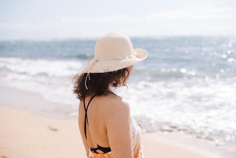 Woman looking at the ocean on the beach