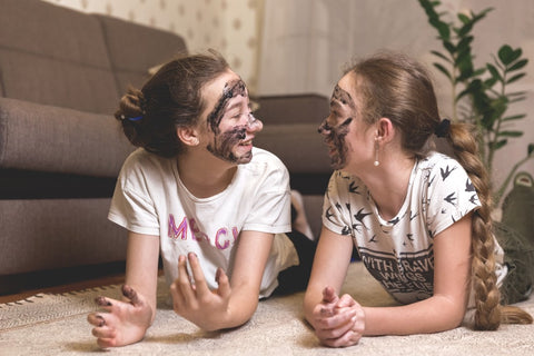 Young girls wearing face masks, laughing