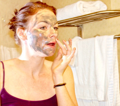 Woman putting on face mask.