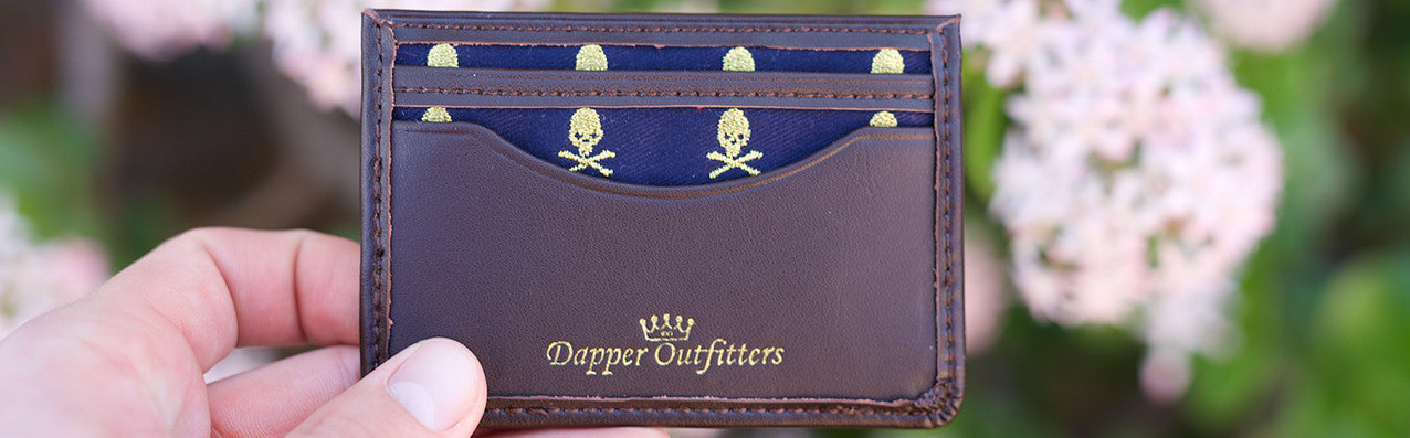 Leather card holder with skull and crossbones