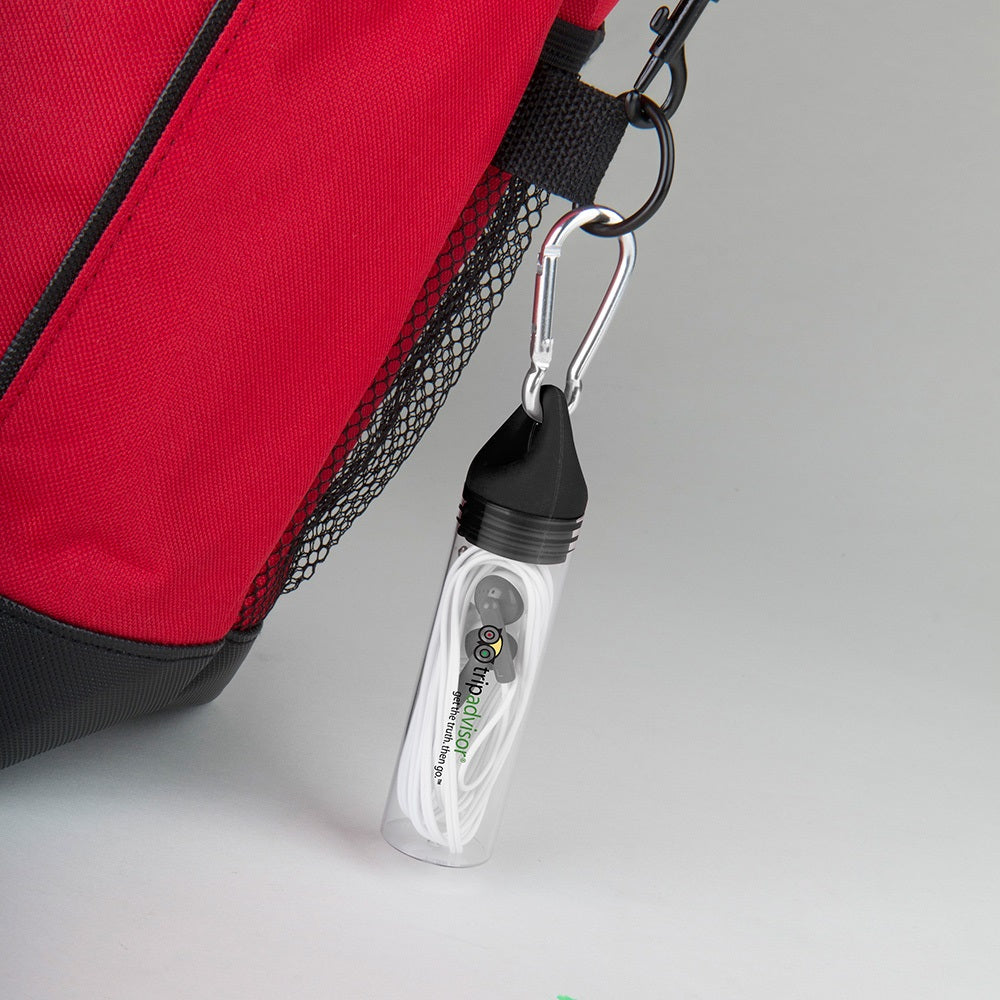 black earbuds clipped onto backpack