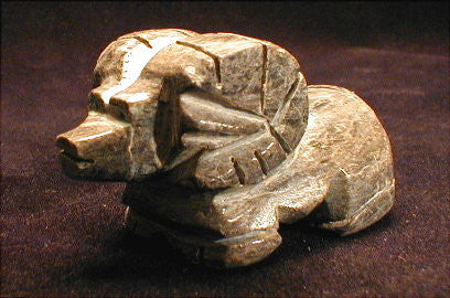 Adorable, tiny ram craftfully cut from dark gray alabaster. Zuni made.