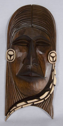 Carving of a Woman's face by Delmar Joseph