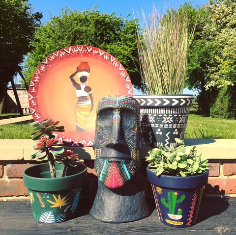 Plant pots and garden ornaments painted with chalk paint