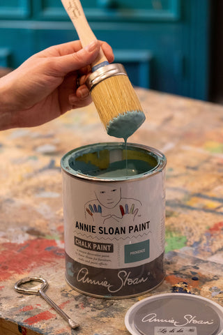 Paint brush dipped in Annie Sloan Chalk Paint