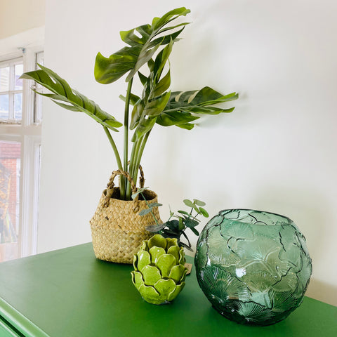 Green accessories with glass vase