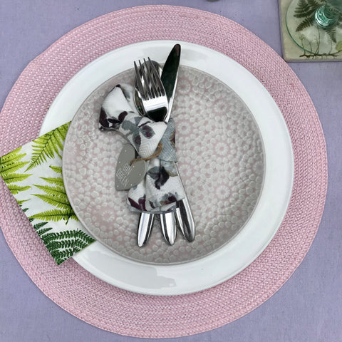 Pink and purple dinner plate setting