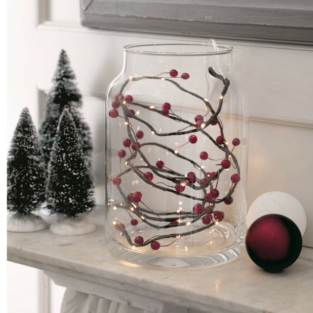 red berry string lights in a jar