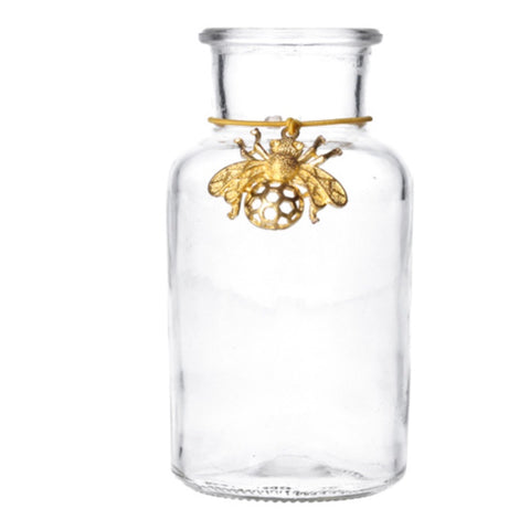 Glass jar with gold bee