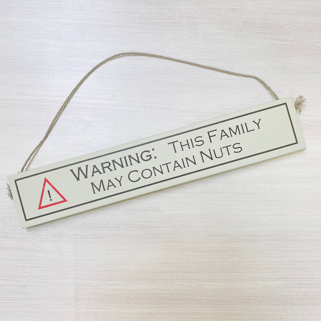 Warning: This family may contain nuts Sign