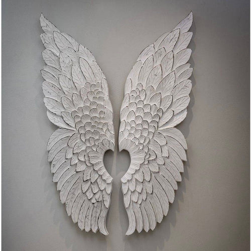 pair of white wooden angel wings
