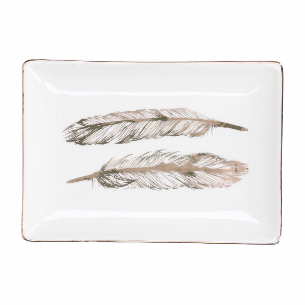 White trinket dish with gold feather pattern