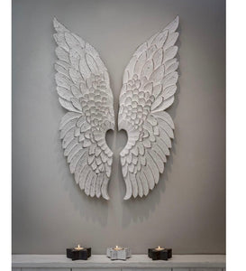 white carved wiodwn angel wings