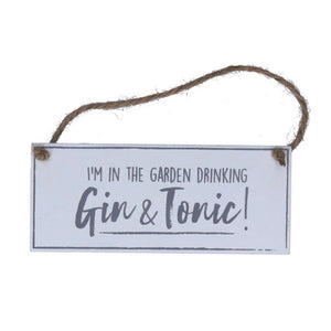 In the garden drinking Gin and Tonic sign