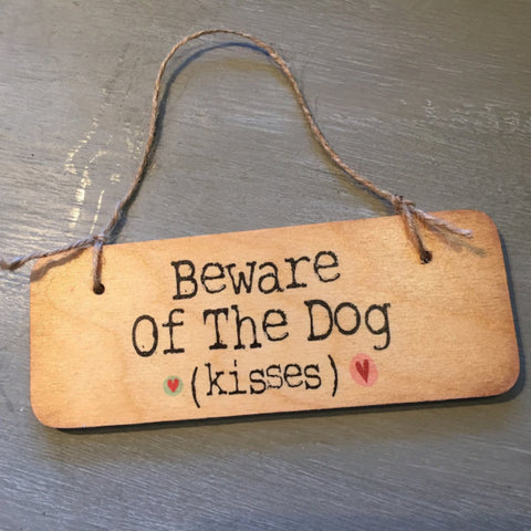 Beware of the dog (kisses) sign