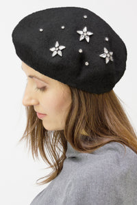 Solid Knit Beret Hat with Rhinestone Floral Embellishment - Just Jamie