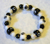 Black and White Evil Eye Bead, Glass and Onyx Stretch Bracelet