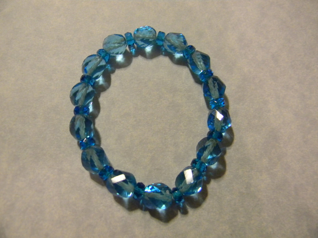 Twisted Turquoise Colored Glass Bead and Teal Rondel Bracelet
