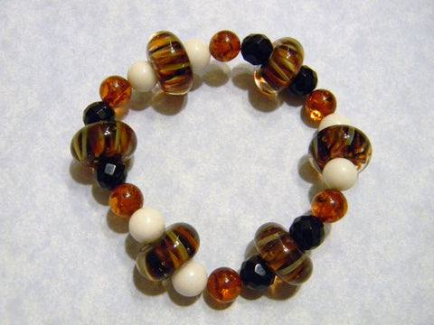 Amber Colored Art Glass, Onyx, Mother of Pearl and Amber Stretch Bracelet