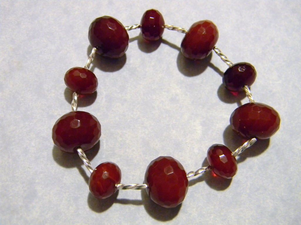 Faceted Dark Red Agate and Twisted Silver Tube Stretch Bracelet