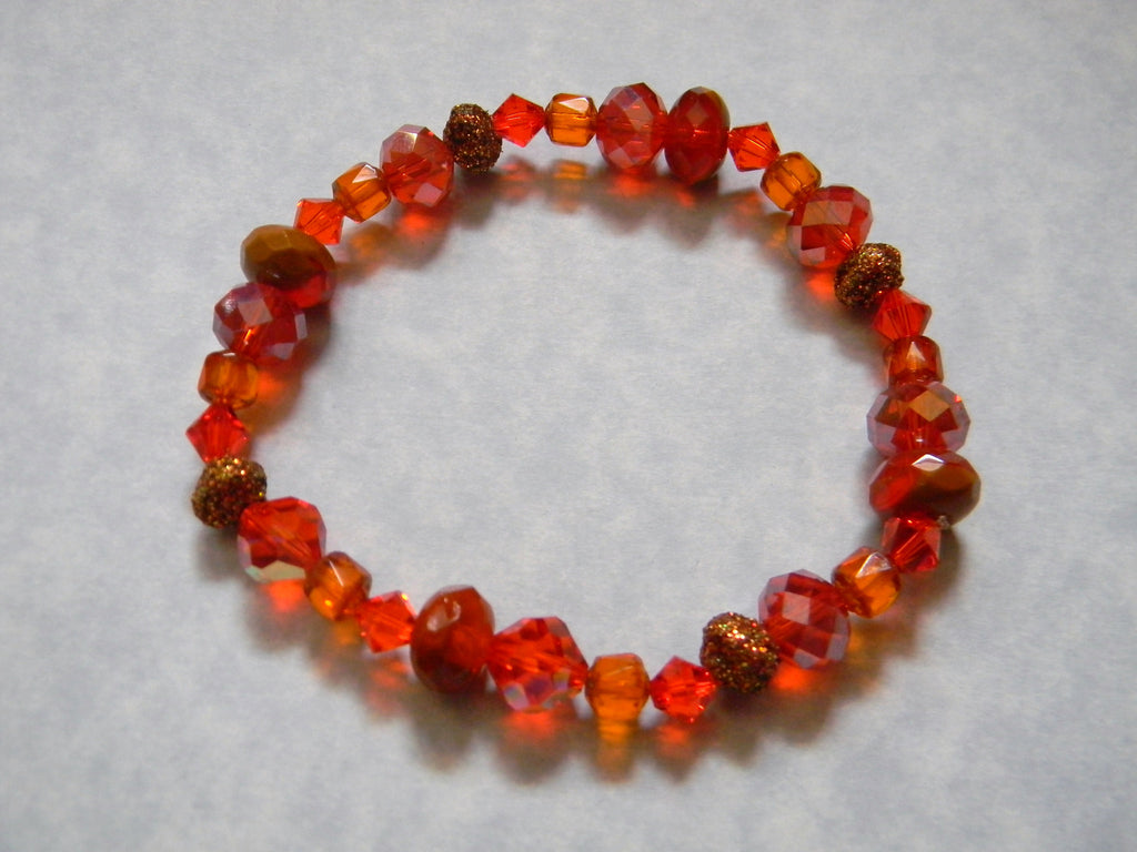 Shades of Bright Orange Faceted Glass, Crystal, Cathedral Bead and Kashmiri Lac Stretch Bracelet