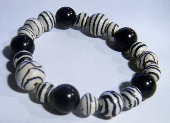 White and Black Zebra Ceramic Bead and Moldovite Stretch Bracelet