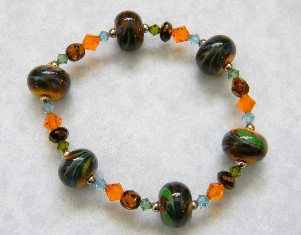 Orange, Brown and Green Art Glass Beads, Crystal and Gold Bead Stretch Bracelet