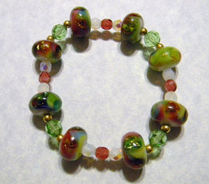 Stretch Bracelet with Pomegranate, Gold, Green & White Art Glass, Crystals and Faceted Glass