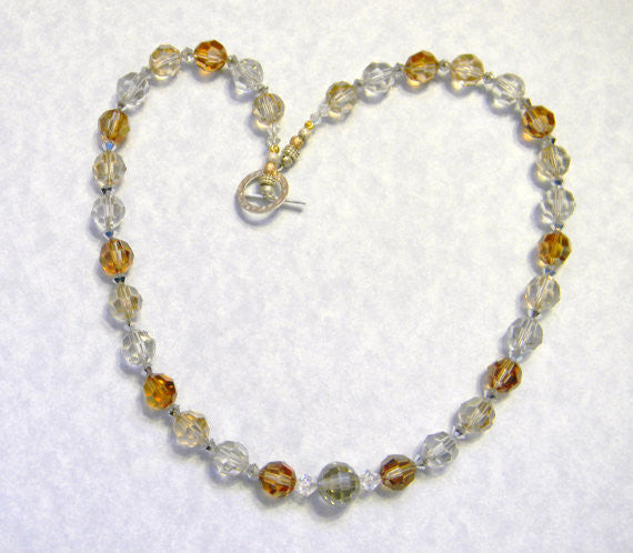 Gold, Silver, and Copper Crystal Necklace with Tricolor Metal Beads and Hammered Silver Toggle