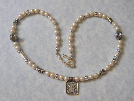 Hammered Silver Hamsa Pendant on Pearl and Silver Necklace