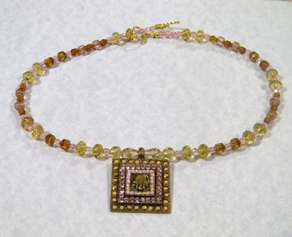 Brass Hamsa and Crystal Pendant on a Faceted Glass Necklace