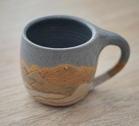 Coco Chispa | Rust & Blue Glaze Mountain Mug