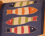 Kate Nelligan's Picket Fish Hook Rug