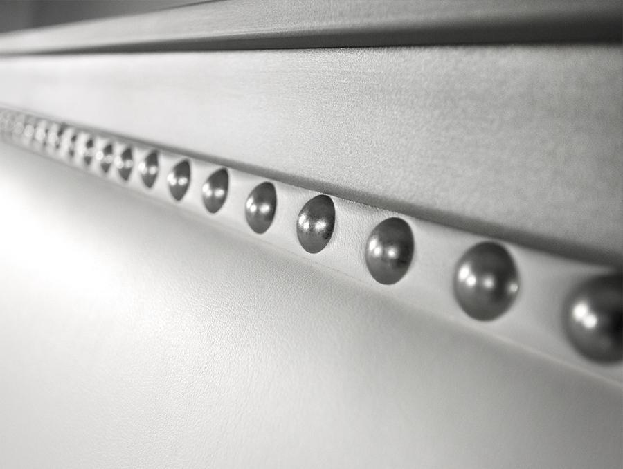 Up close view of the Nail Head Design of the Avery Upholstered Iron bed from Wesley Allen
