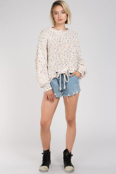 Dotted multi knit boxy sweater with distressed hem details