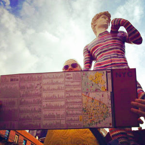 david statue in New York wearing Missoni fashion with a person holding a map