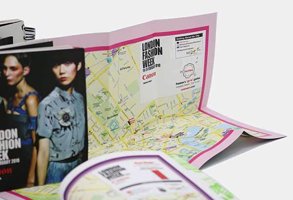 London Fashion Week attendee program booklets with maps of London.