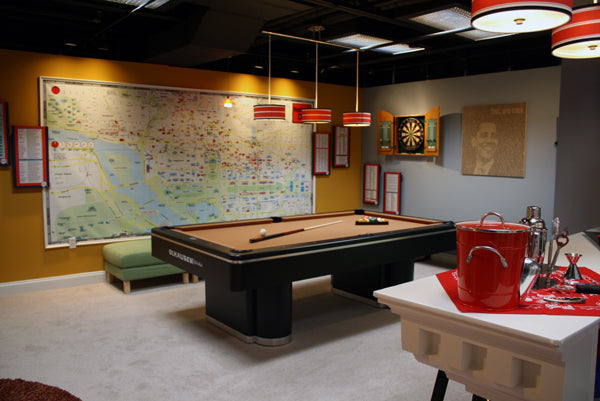 Game room with a wall map in the MTV Washington DC Real World House 2019..