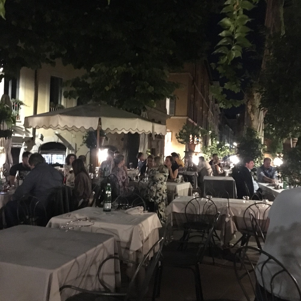 Santa Lucia restaurant in Rome nighttime view of the patio dining area