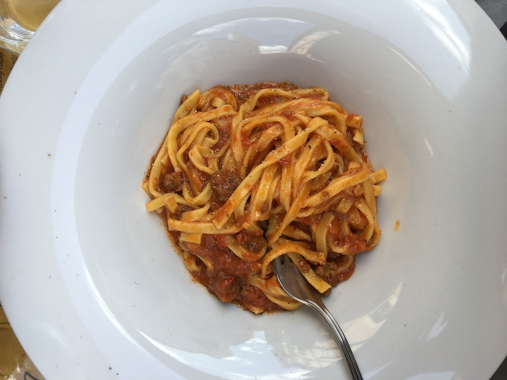 bowl of pasta with red sauce at Solo Vineria e Gastronomica in Rome