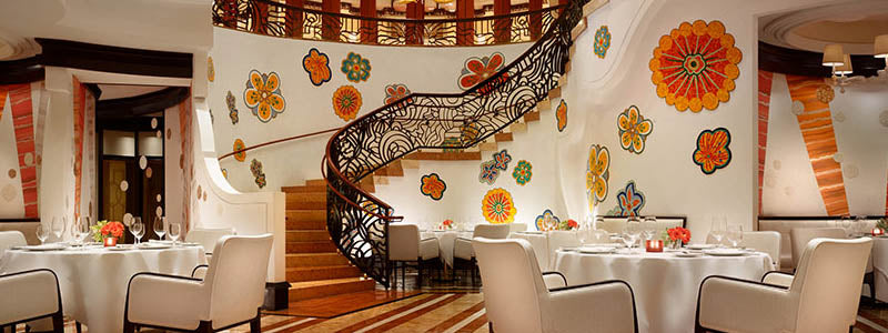 colorful Wynn Resort restaurant interior with staircase