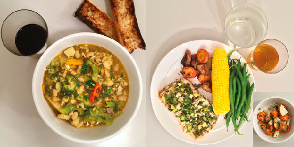 photo of hearty meals with soup, fish, corn on cob and wine