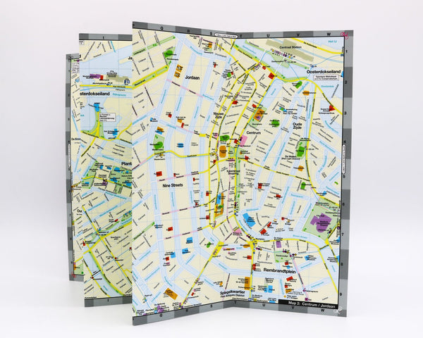 Foldout Amsterdam travel map showing cultural attractions in the city center.