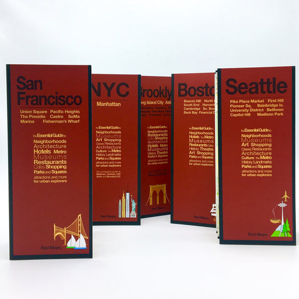 Five foldout city maps with red covers to Boston, Seattle, NYC, San Francisco, Brooklyn and Long Island City