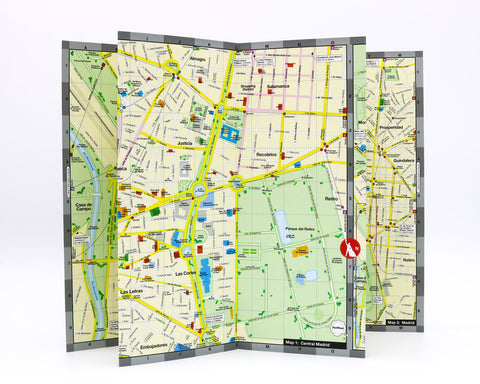 accordian fold map of Madrid that shows Park Retiro, the Prado Museum and the hotels and shopping of the Salamanca area.
