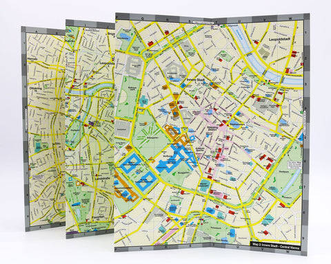 A foldout Vienna map that shows the museums, shopping, hotels and theatre near the Hofburg Palace in the historic city center.